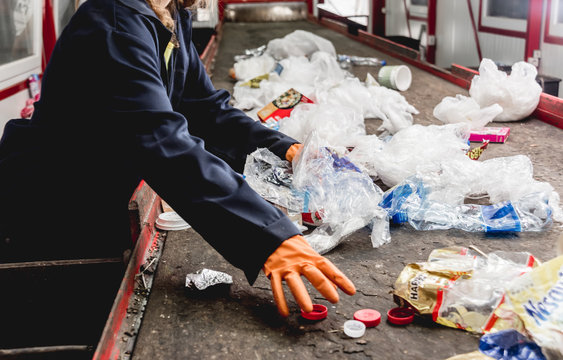 At modern recycling plant. Separate garbage collection. Workers sorting trash to be processed. Trash sorting.