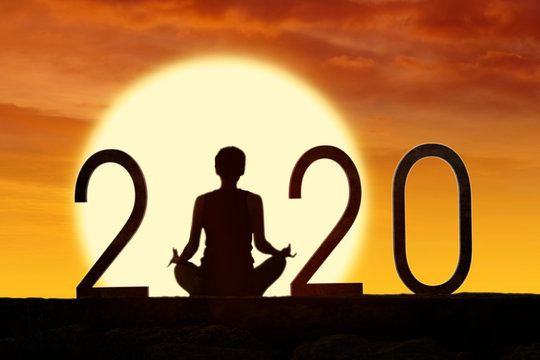 Silhouette woman practice yoga with number 2020