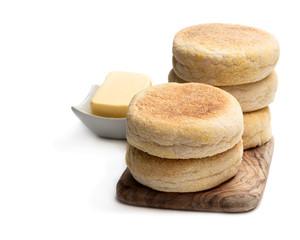 Fototapeten Brot Freshly baked English muffins isolated on a white