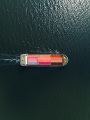 Aerial top view small container cargo ship for business logistics, import export, shipping or transportation.
