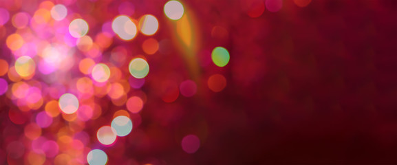 Red and pink soft defocused holidays lights background