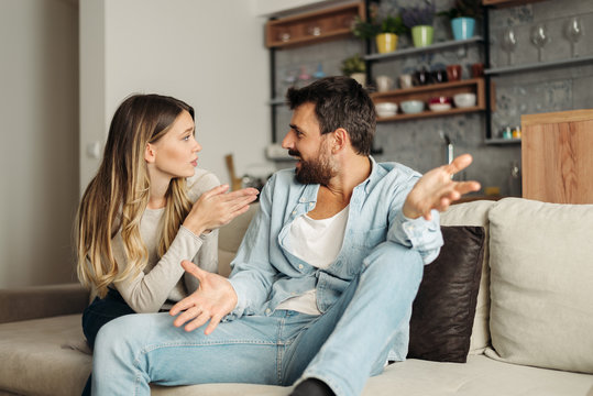 Frustrated young couple arguing at home