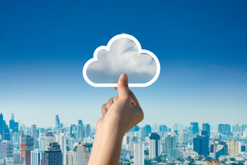 Concept of download on cloud storage.Woman hand holding picture on cloud sky background. The development of the imagination, copy space.