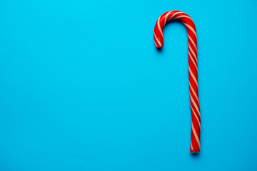 Christmas candy cane on blue background