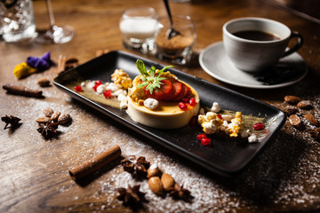 Toffee Panna Cotta served with a cup of coffee