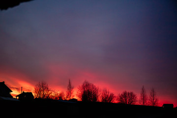 Very beautiful sunset in the village. The red sky is ablaze.