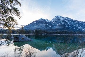 Lake Hintersee, Ramsau, Bavaria in winter at sunrise and reflexion