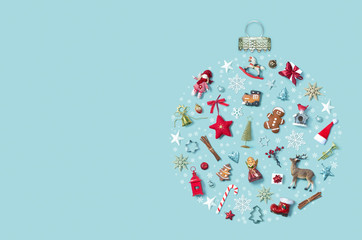 Christmas holiday background with objects in bauble ornament shape, top view