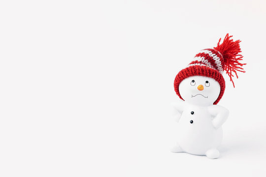 Business important snowman standing isolated on white background. Merry christmas and happy new year greeting card. Funny snowman in hat on snowy background. Copy space for text