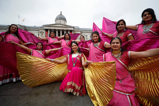 Dancers pose for a photograph during Diwali celebrations in Trafalgar Square