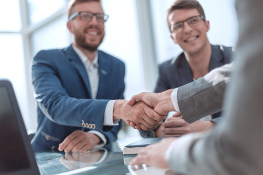close up. successful business people shaking hands