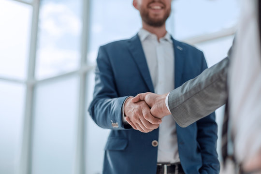 business partners shaking hands . concept of partnership