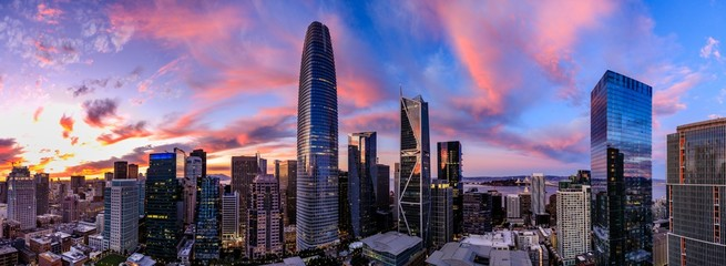 Epic panorama of a pink and blue sunset over San Francisco skyline with Salesforce Tower in the center and the bay bridge on the right