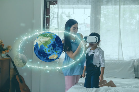 smart learning with augmented mixed virtual reality technology education concept, mother try to teach daughter by using artificial intelligence in subject in math, Science for creation, interaction,