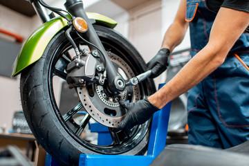 Repairing motorcycle at the workshop Papier Peint