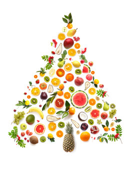 New Year or Christmas tree made of various fruits isolated on white background, top view, flat layout.