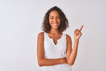 Young brazilian woman wearing casual t-shirt standing over isolated white background with a big...