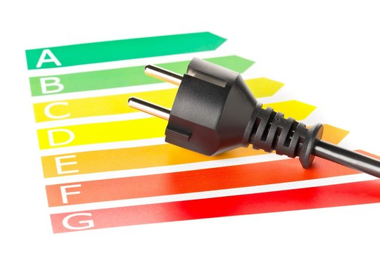European energy classification labels with power cord on white - energy saving or power consumption concept