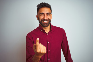 Young indian man wearing red elegant shirt standing over isolated grey background Beckoning come here gesture with hand inviting welcoming happy and smiling