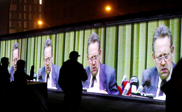 Historic video footage from former official of the Socialist Unity Party of Germany Guenter Schabowski is projected during a rehearsal with 3D video beamers on the East Side Gallery, the largest remaining part of the former Berlin Wall, in Berlin