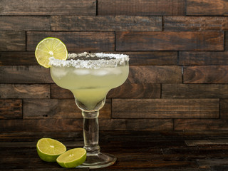 Margarita cocktail drink with lime on ice
