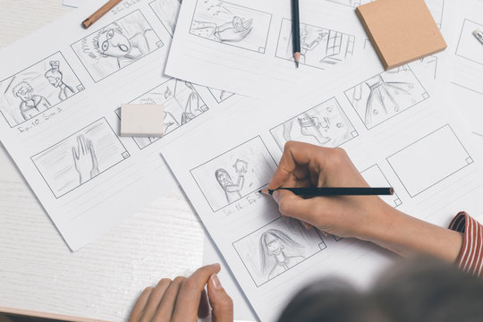 Hands draw a storyboard for the film.