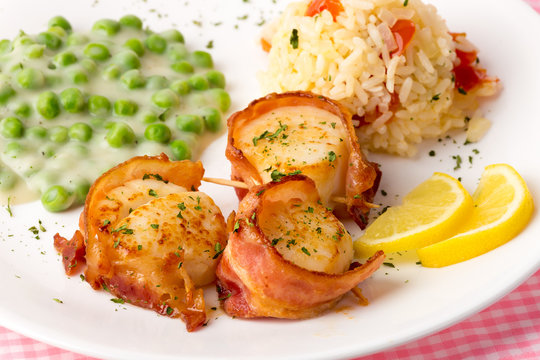 Bacon-wrapped Scallops with Creamed Peas and Rice Pilaf with Lemon Slice