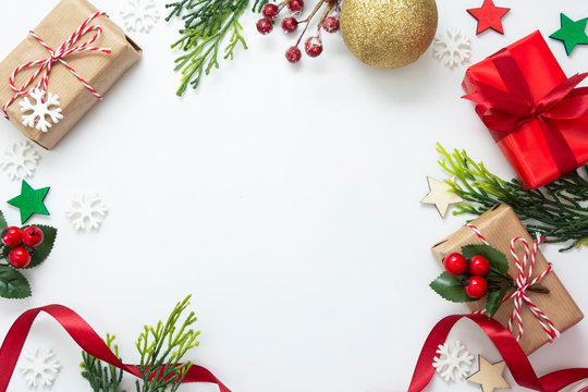Christmas backgrond with gift boxes, red ribbon, winter decorations, isolated on white background. Christmas and New year concept. Mock up, copy space. Flat lay, top view.