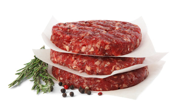 Raw meat cutlets for burger isolated on white