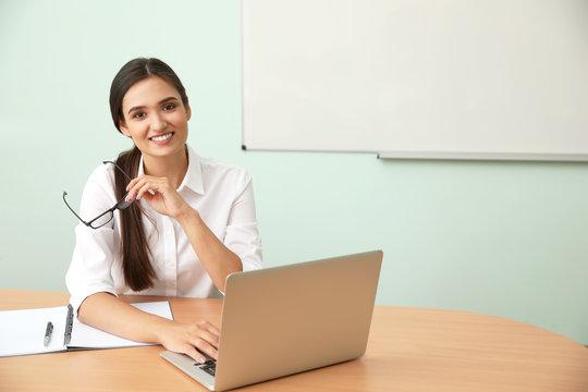 Female teacher at her desk in classroom