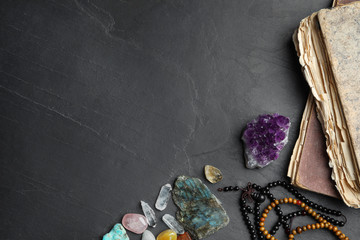 Flat lay composition with different gemstones on black background. Space for text Wall mural