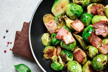 Photo sur Plexiglas Bruxelles Delicious Brussels sprouts with bacon in pan on light table, closeup