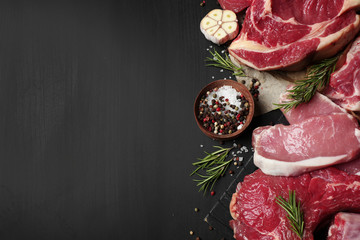 Flat lay composition with fresh meat on dark table. Space for text Wall mural