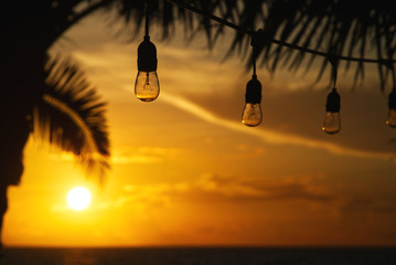 fairy lights in the sunrise at a caribbean beach in mexico