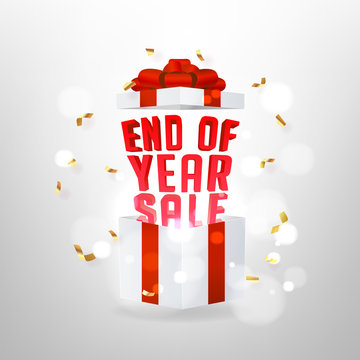 End of year sale banner. Opened gift box with red bow and magic effect.