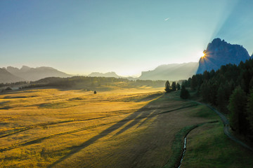 Aerial view of the valley in the fog during dawn in the Alpe di Suisi region. Dolomites in Italy in the fall Wall mural