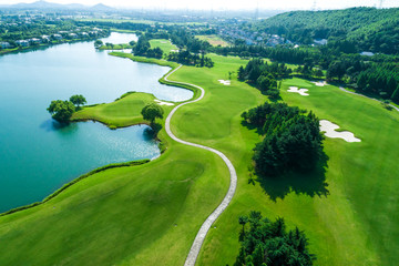 Aerial view of golf course and water Fotoväggar