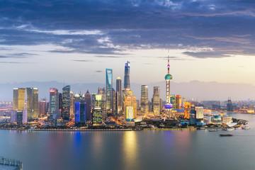 Fotobehang - shanghai skyline in nightfall