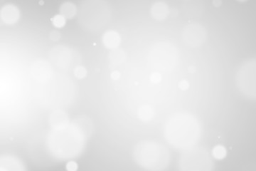 Bokeh abstract blurred gray and white beautiful background. Soft color light glitter sparkles. element for backdrop or design cosmetic ads, winter, christmas, luxury, beauty, baby, modern, creative