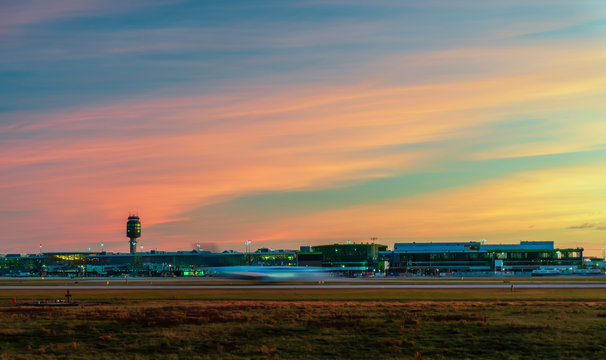 Red-blue cirrus clouds in the evening sky over the airport