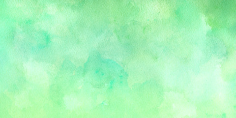 Green blue watercolor background texture in light pastel colors in pretty summer or spring green