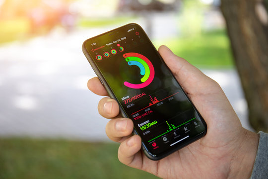 Man hand with Apple iPhone 11 with app Activity