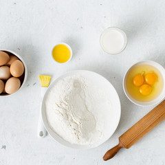 Fototapete - Dough ingredients on a white background top view