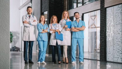 Team of doctors in hall of clinic