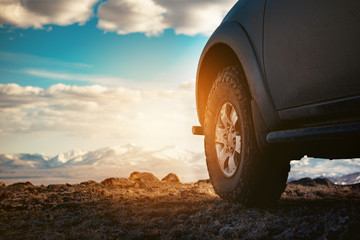 4x4 car wheel against mountains