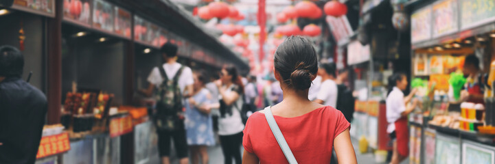 China food market street in Beijing. Chinese tourist walking in city streets on Asia vacation tourism. Asian woman travel lifestyle panoramica banner.