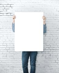 Man holding blank banner