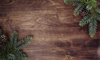 New Year's background. Spruce branches on a wooden table. Ornaments for the New Year tree....
