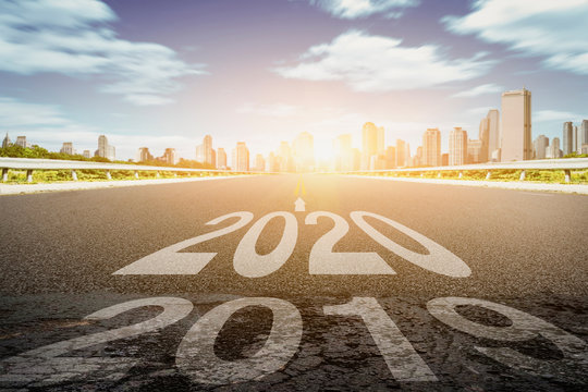 Asphalt road with the inscription 2019 2020. Concept of the departing old year and new goals. Happy New Year 2020 Concept. - Image