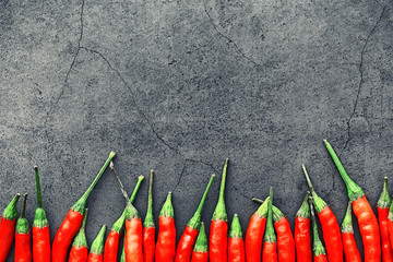 In de dag Hot chili peppers Hot red pepper. Chilean pepper on a black.